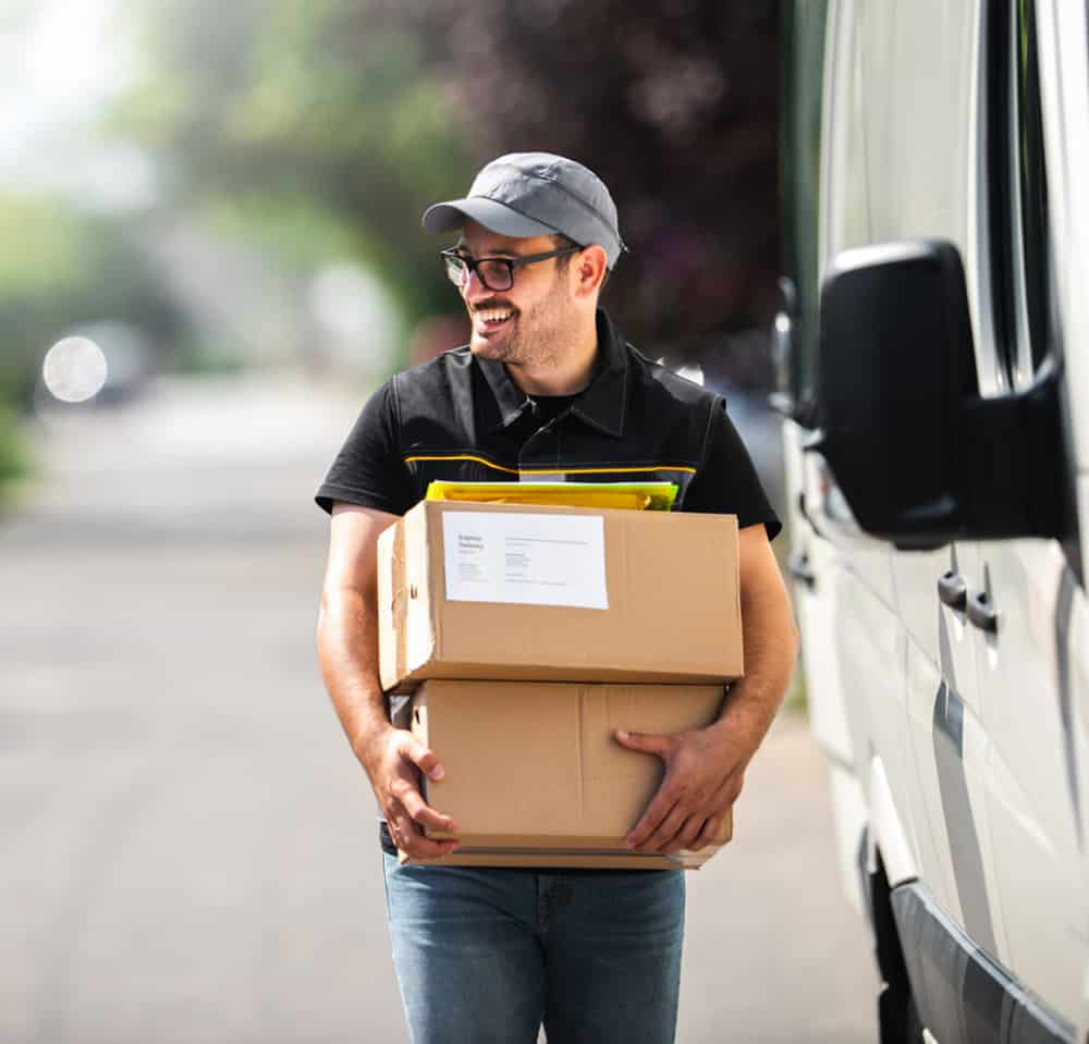 mail carrier with 2 packages and clipboard